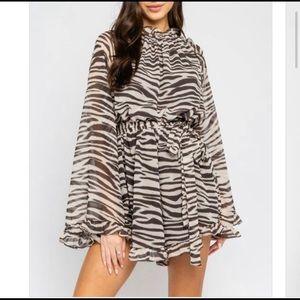 Zebra print long bell sleeve romper